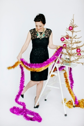 Yes, this IS how I look when decorating the tree... except for the heels.. and the LBD and the super posh hairdo.. but otherwise its me to a tee!